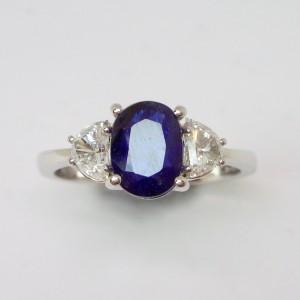 Sapphire and half moon cut diamond ring