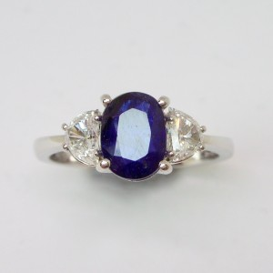 Sapphire and half moon cut diamond ring