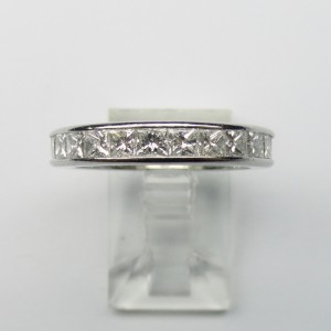 Eternity ring with princess cut diamonds in platinum