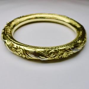 Bracciale rigido in oro bicolore