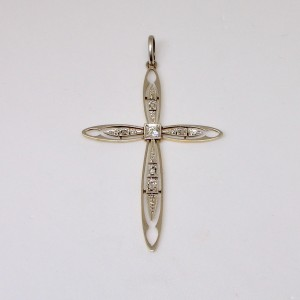 Platinum and gold cross with diamonds